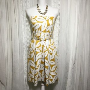 Strapless yellow and white pattern belted dress